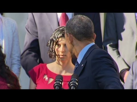 Obama Catches Fainting Pregnant Woman.