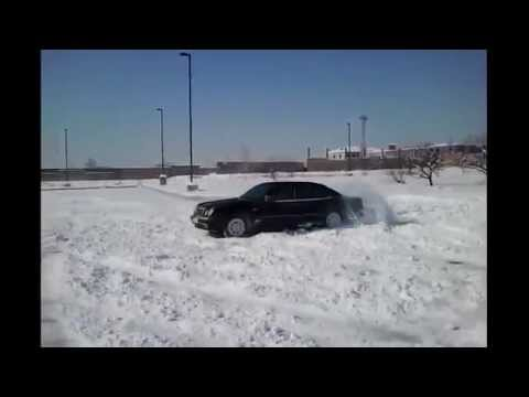 Luxury Vehicle Mercedes E320 4MATIC Snow Drifting