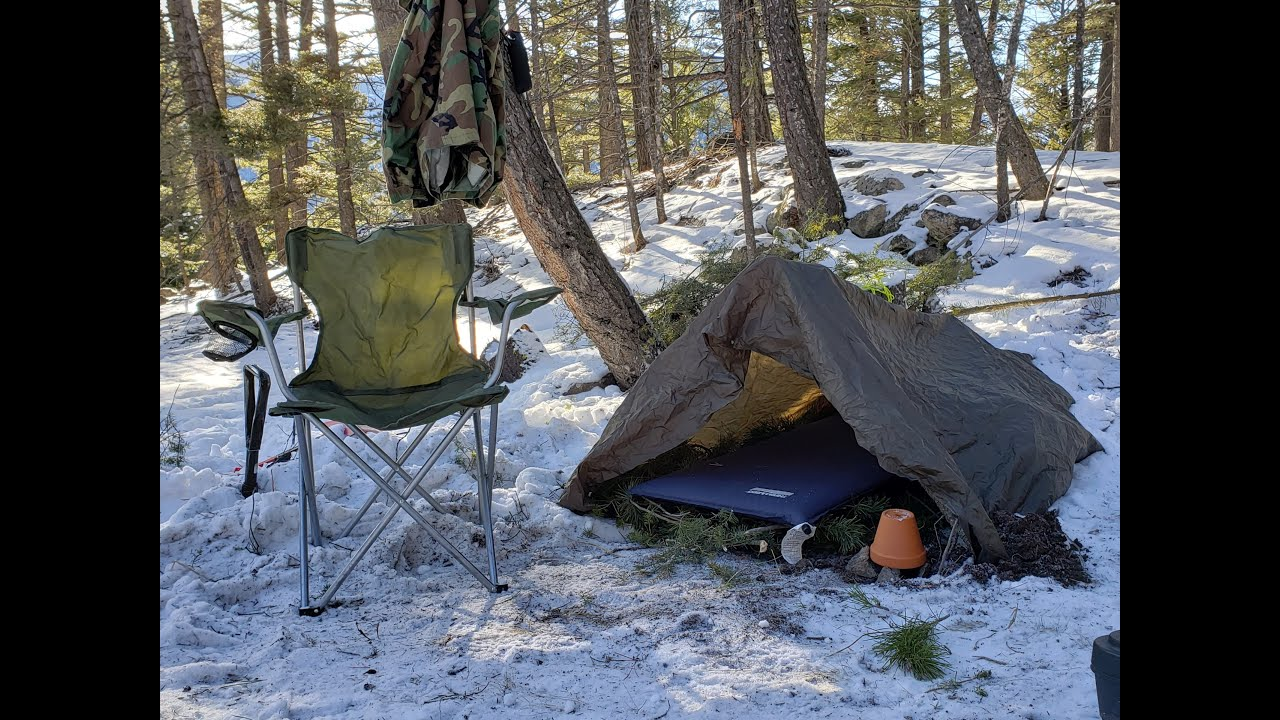 Winter camping in a Survival Shelter - YouTube