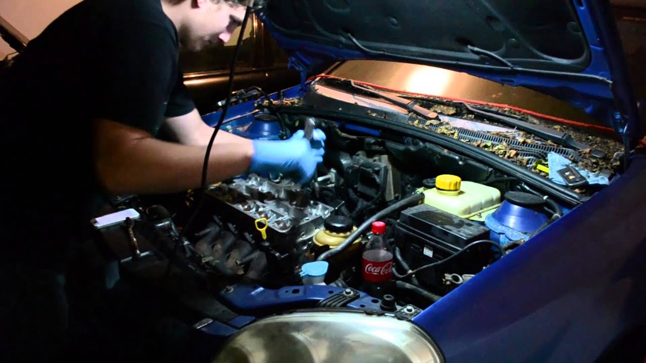 2006 suzuki forenza head gasket repair, bolting the head back on