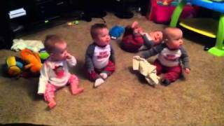 Quadruplets entertained by big sister