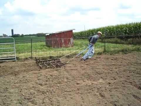 Plow   agriculture   Britannica.com   People Pulling Harrows