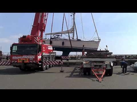 LIEBHERR crane lifting sailing boat