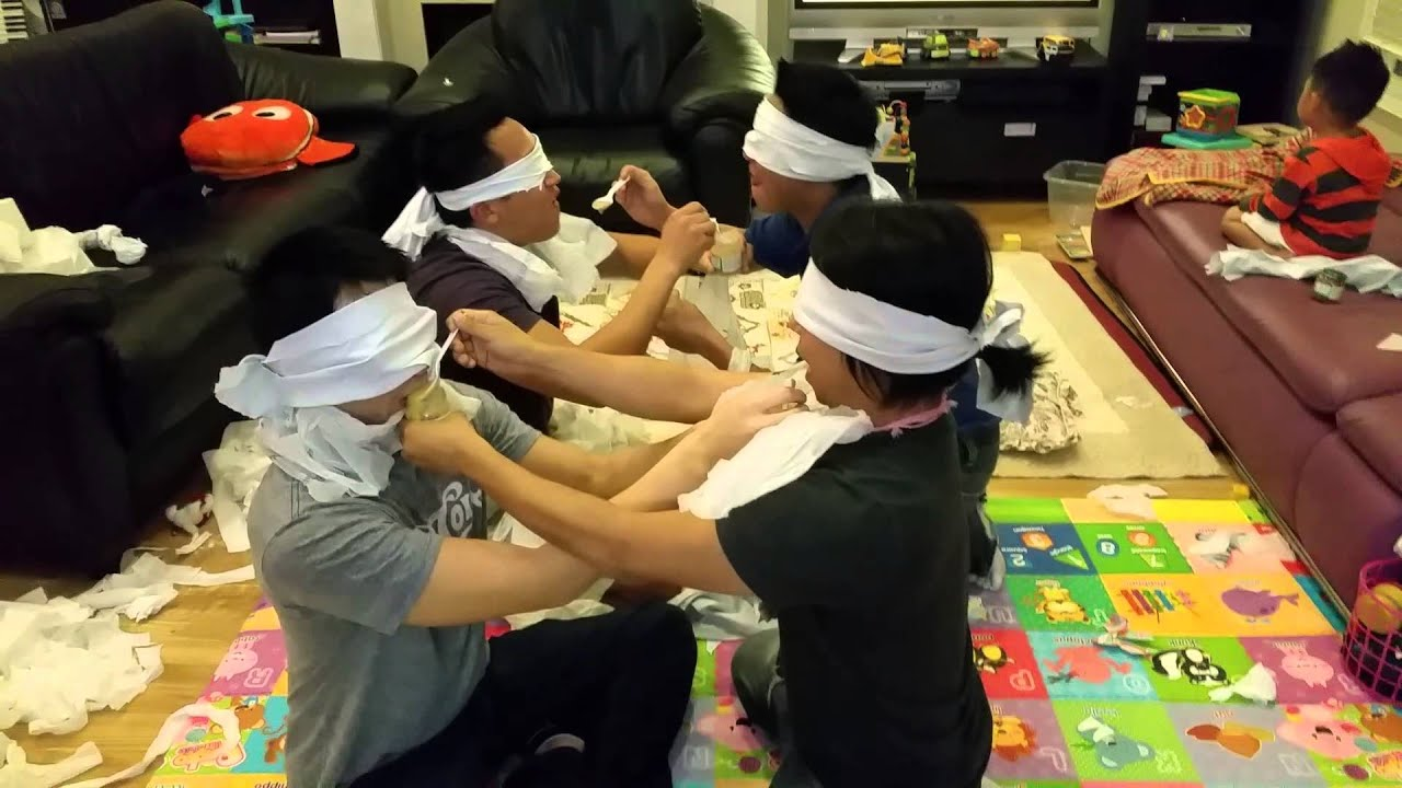 Baby shower game blindfolded feeding each other