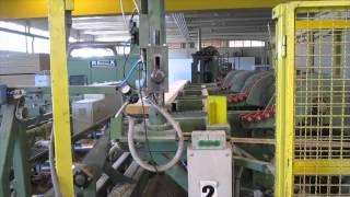 Подача пиломатериала в линию пр-ва строительного бруса
