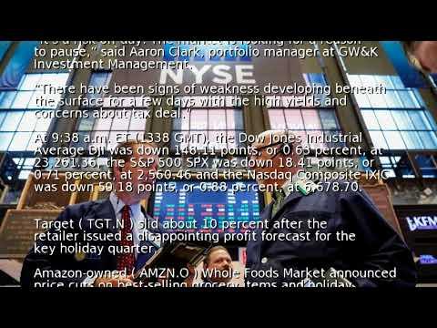 Wall Street falls as oil slide, tax bill concerns weigh