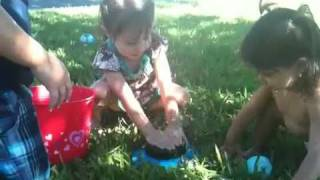 Gaby, Karina and Zander playing in the yard