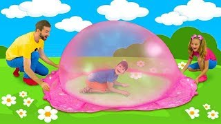 Sasha and Max play with colored mud and make big mud bubbles