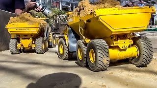 RC 6x6 dump trucks BELL at construction site work! RC-Glashaus action!