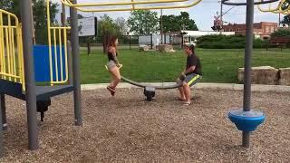 Girl Flies off Front of Seesaw - 989909