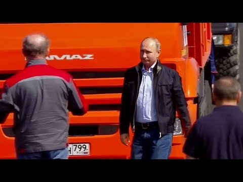 Putin drives a construction truck to test the newly completed bridge
