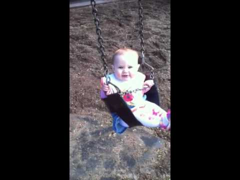 Brianna on swing at fitzroy gardens