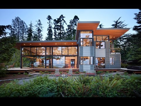 Contemporary Glass House Design with Metal Siding