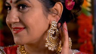 Beautiful Indian housewife / woman wearing earrings / jhumka for a festive function