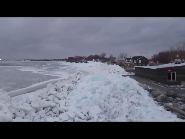 Standing on 35 ft of Ice piled up by high winds along Lake Erie Shore line 2/25/2019