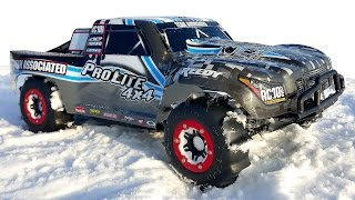 rc cars bashing in snow short course truck team associated prosc 4x4