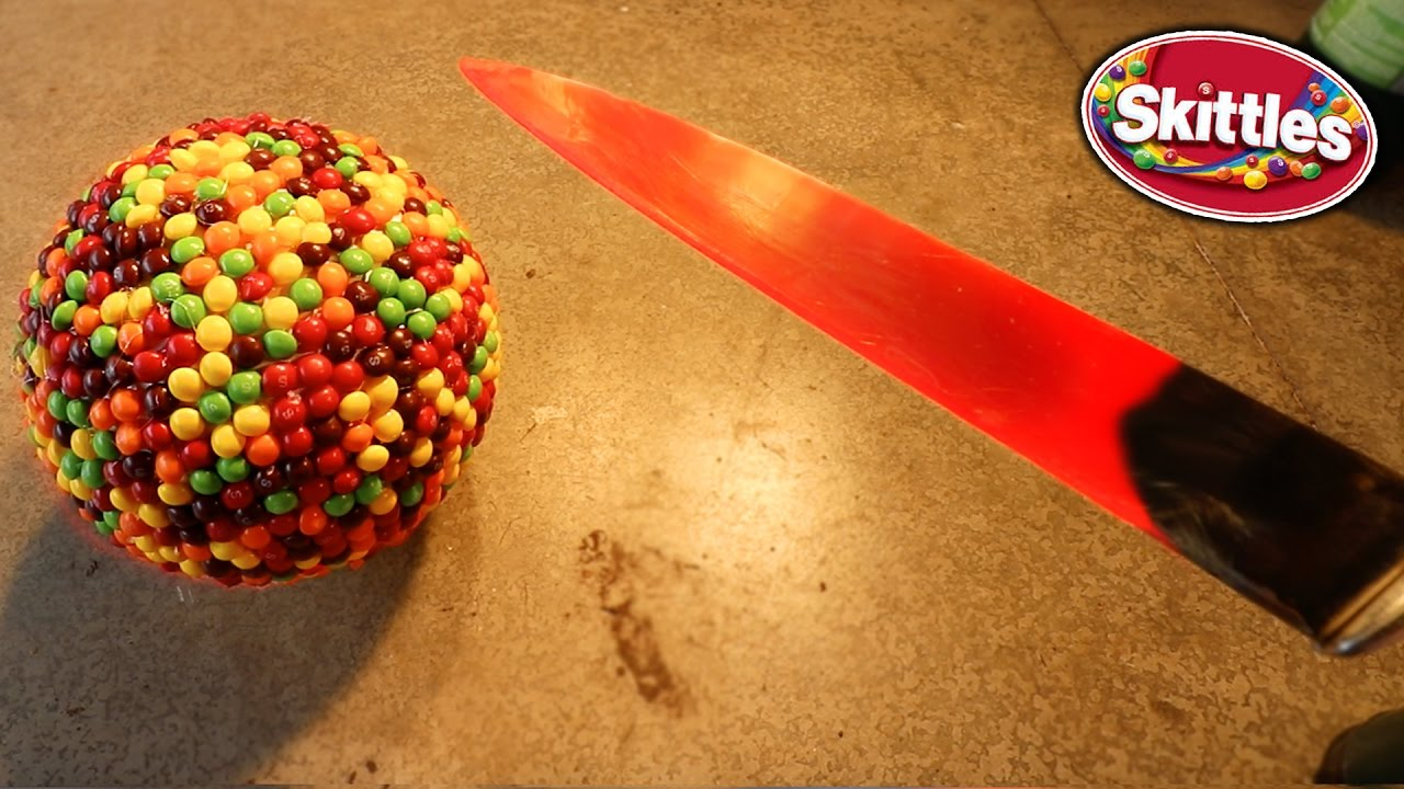 glowing 10000 degree knife vs giant skittles ball experiment