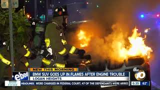 Driver gets out of BMW SUV just before it bursts into flames