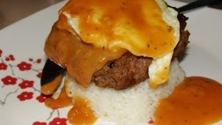 Loco Moco (a Hawaiian Dish Of Hamburger Steak, Egg Over Easy And Brown Gravy Over Rice)