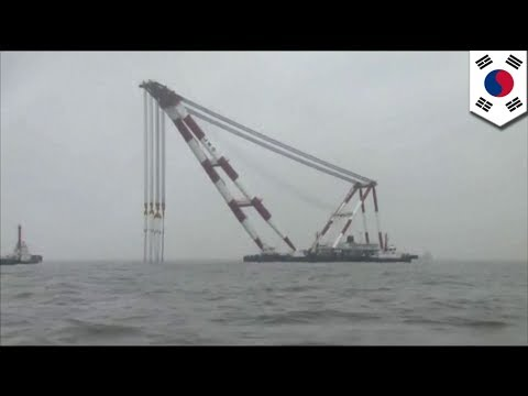 Massive floating cranes move into position of sunken South Korean ferry