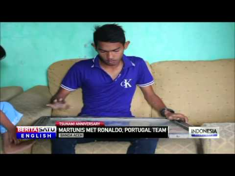Boy Seen Clinging to Tree Branch in Aceh Tsunami Disaster Meets Portuguese Footballers