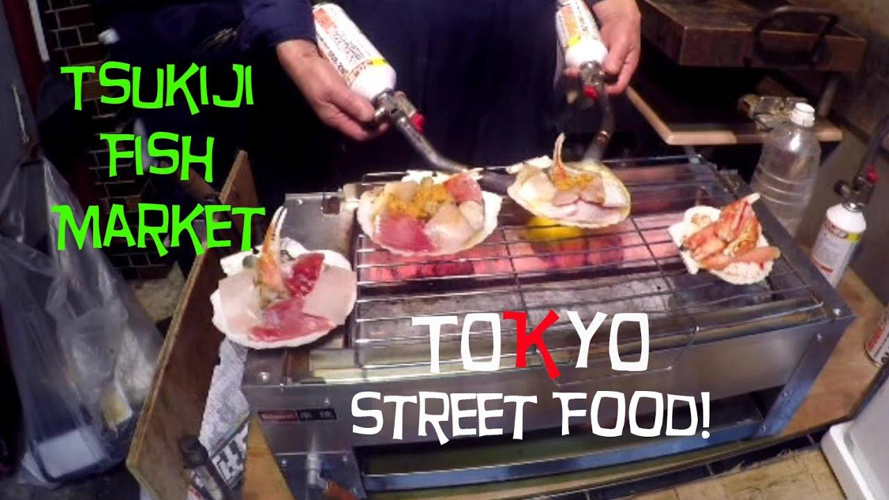 trying out street food at tsukiji fish market  tokyo