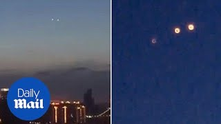 Chinese puzzled by three UFOs spotted moving across the country - Daily Mail