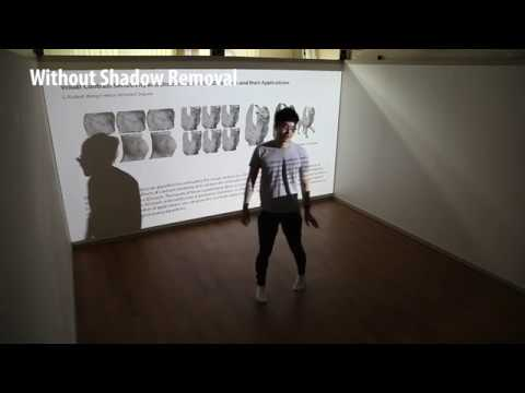 Real-time Human Shadow Removal in a Front Projection System