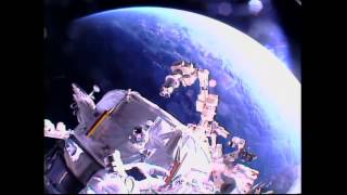 American Astronauts Install New Docking Port for U S  Commercial Crew Vehicles