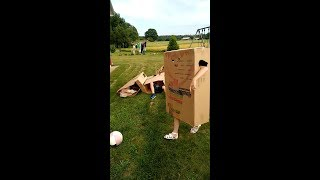 "Funny Children plays ""cardboard"" football, soccer."