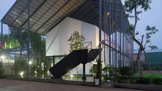 Green and Industrial Office in Vietnam Housed Under a Giant Shed!