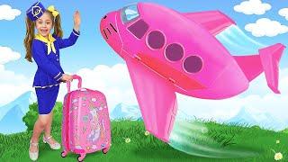 アニタとパパは巨大なおもちゃの飛行機で大きな冒険に乗り出します