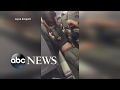 Man dragged off flight by law enforcement after not giving up seat