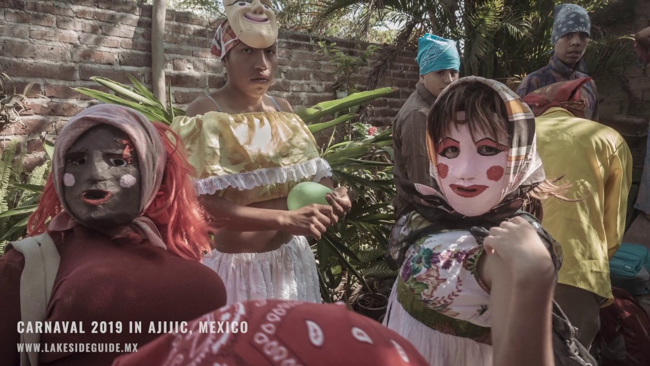 Resultado de imagen de Carnaval in Ajijic is one of the town's most rambunctious fiestas, involving a major parade filled with allegorical floats & the town's crossdressing masked sayacas.""