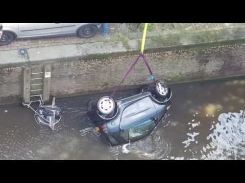 Smart car dredged up from Amsterdam Canal following Hollywood shoot. Part 1