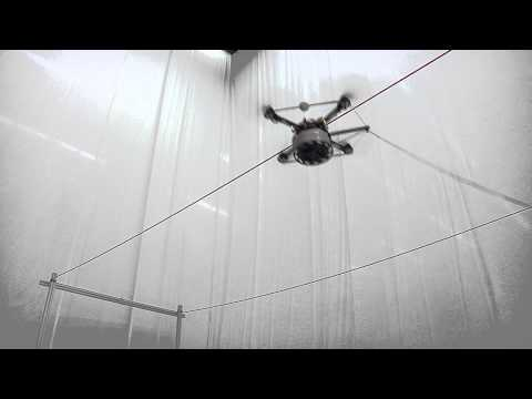 Building Tensile Structures with Flying Machines