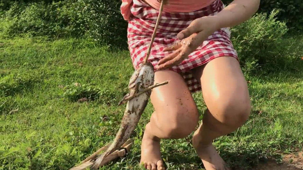 Top viral fishing video beautiful girl use primitive bow for Topless girls fishing