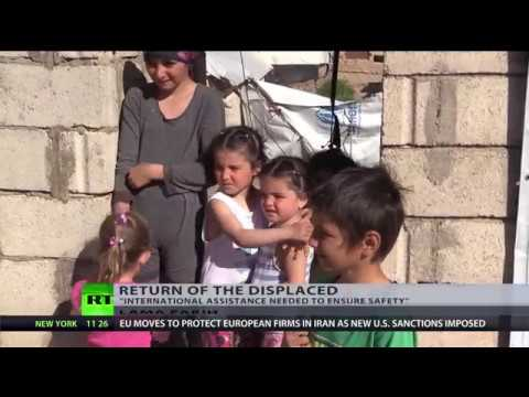 Return of the displaced: Syrian refugees seek to return home as war ends