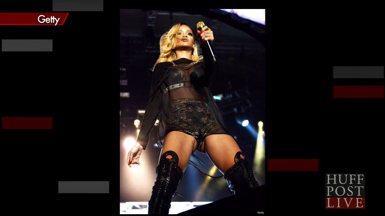 Rihanna holding her crotch