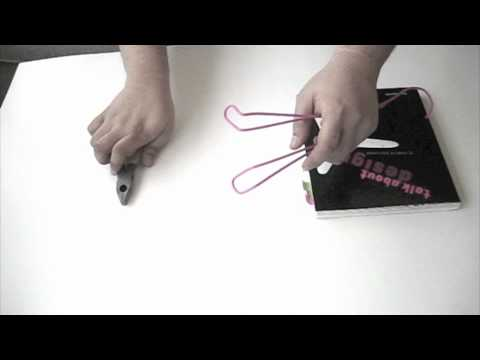 How to make a book stand with a hanger m4v youtube how to make a book stand with a hanger m4v malvernweather Images