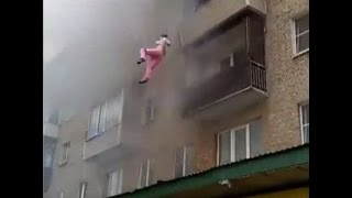 LiveLeak - Family with children jumped out of windows to escape the fire
