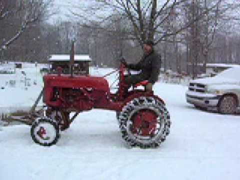 1949 farmall cub plowing snow