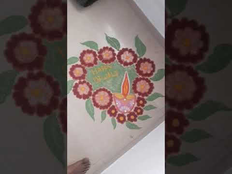 Diwali Rangoli with flower frame and diya( tutorial check on channal)