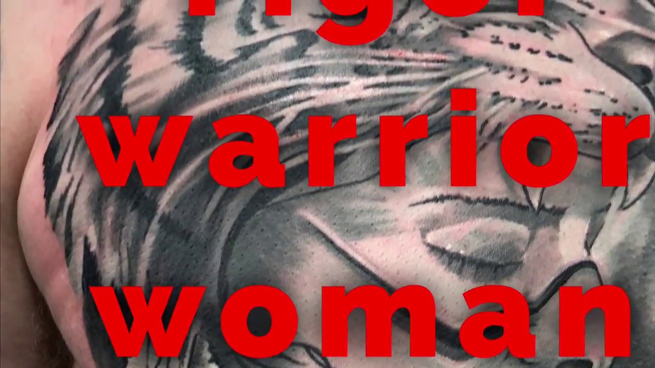 80a31b97876e1 Tattoo tiger warrior woman on chest - YouTube