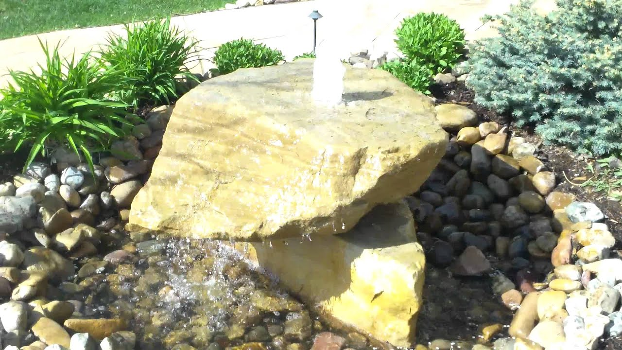 denver landscape contractor installing a bubbling rock water feature in westminster colorado