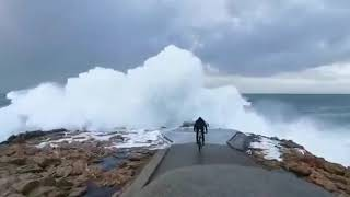 Boy Gets Swept Off His Bike by Large Waves in Galicia, Spain