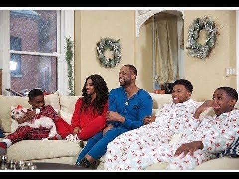 Dwyane Wade & wife Gabrielle Union shoot funny Christmas Family Video (with dogs & kids)