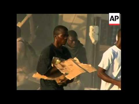 People scavenge for items at business premises in Port-au-Prince