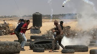 Palestinians mourn and protest after deadly day in Gaza