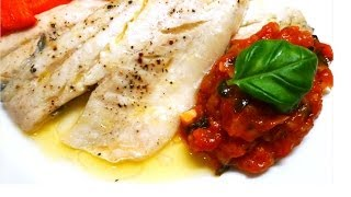 Roasted Sea Bass in lemon juice and butter, served with tomato and basil sauce.